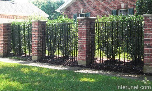 Brick and Metal Interchange Garden Fence